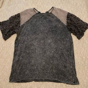 Tunic top with black lace sleeves.